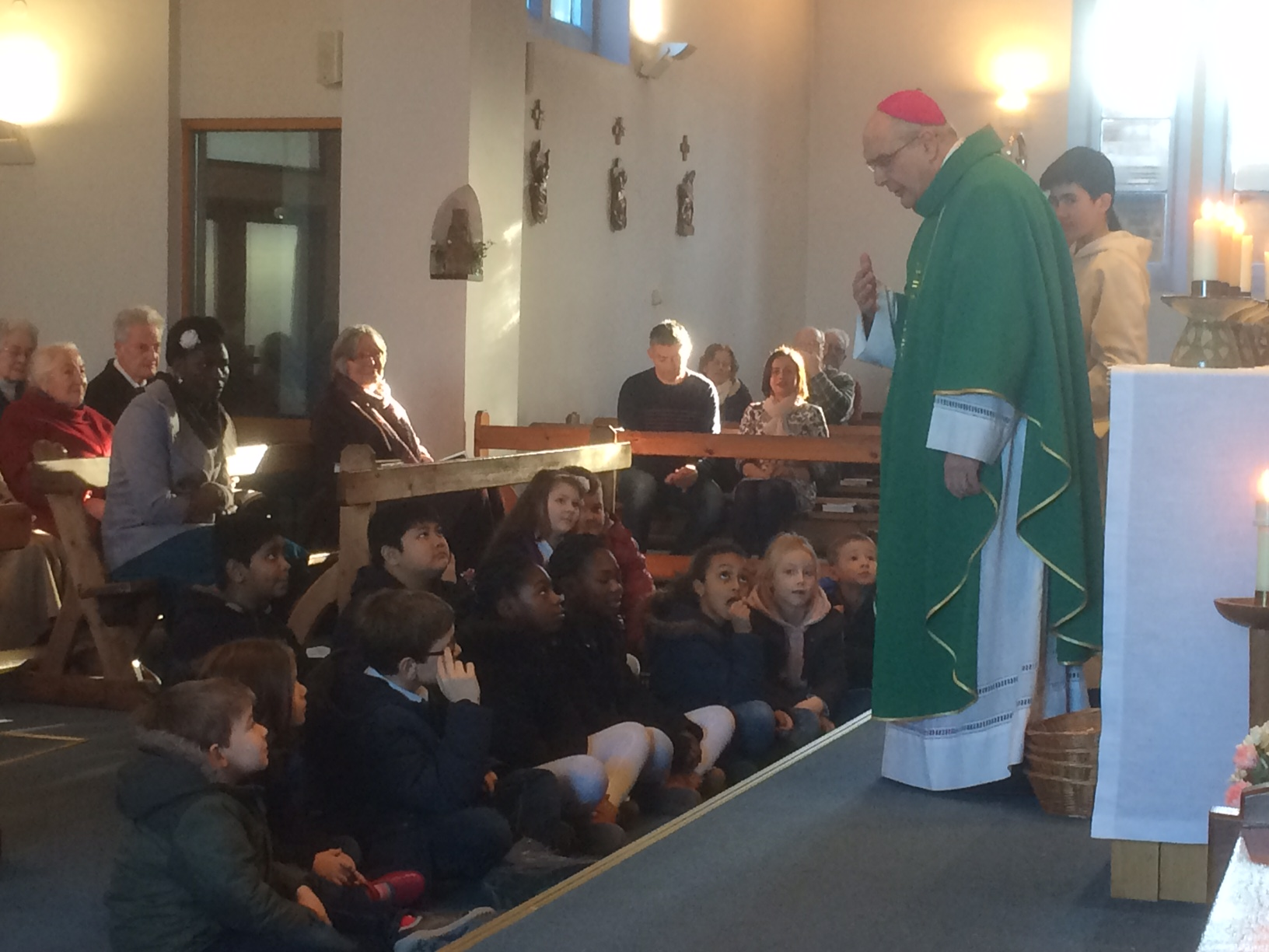 Bishop Alan explains to the children at Our Lady's what a bishop is and does